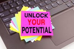 Unlock Your Potential writing text made in the office close-up on laptop computer keyboard. Business concept for Self-Development. Improvement on the black Stock Image