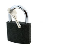 Unlockable lock. With single key isolated on white stock photography