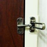 Unlocked bar door guard Royalty Free Stock Photo