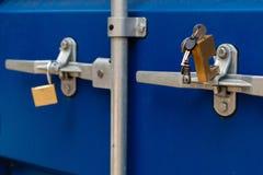 Unlocked clasp and padlock on a storage container. Unlocked clasp and padlock on a storage container stock photos