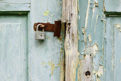 Unlocked. Detail of the broken lock and door - unlocked Stock Photo