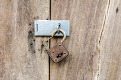 Unlocked key on old wooden door. (Retro object Royalty Free Stock Image