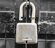 Unlocked lock on the gate Stock Photography