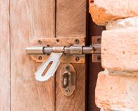 Unlocked old door. Brown metal unlocked old door Royalty Free Stock Images