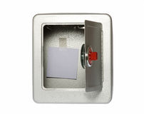 Unlocked, Open, Empty Safe with a Blank Note. Unlocked, open, empty combination lock metal safe with a blank note taped to the wall inside the safe, isolated on Royalty Free Stock Photos