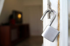 Unlocked padlock. With chain at blue wooden door Royalty Free Stock Photo