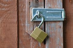 Unlocked Padlock on Door. Unlocked Padlock on Wood Door Latch Royalty Free Stock Images