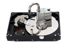 Unlocked Padlock on a Hard Disk Drive Stock Photos