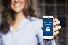 Unlocked phone message. Woman holding a mobile phone with a hand. Royalty Free Stock Image