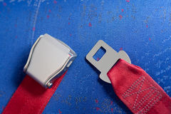 Unlocked seat belt lays on the chair. Royalty Free Stock Photography