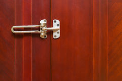 Unlocked stainless steel safety latch. At home Stock Photos