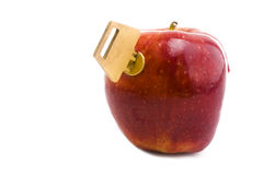 Unlocking the Apple. Key inserted into a red apple Stock Photo