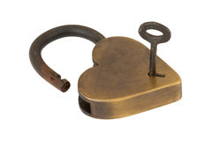 Unlocking the brass heart lock isolated. Royalty Free Stock Photos