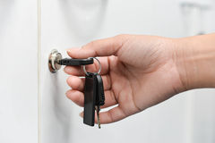 Unlocking the cabinets with key. Hand is Unlocking the cabinets with key Stock Image