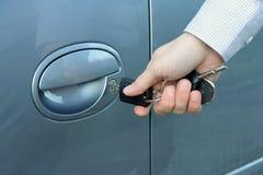 Unlocking the car. Driver unlocking or locking his car with key Royalty Free Stock Photo
