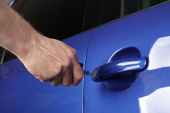 Unlocking a car door. With a key Royalty Free Stock Images