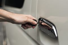 Unlocking a car door with a key Royalty Free Stock Images