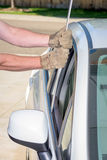 Unlocking a car door using a bar Stock Images