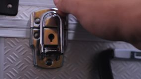 Unlocking A Case Latch. Stock video in 4k or HD resolution stock footage