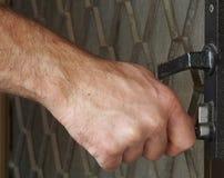 Unlocking the door. A hand unlocking a door royalty free stock photo
