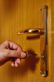 Unlocking door with key Stock Images