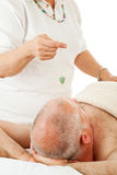 Unlocking Energy Centers. Healer uses a jade pendulum to unblock her patient's energy centers Stock Images