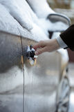 Unlocking a frozen car door Royalty Free Stock Image
