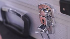 Unlocking And Locking A Case. Stock video in 4k or HD resolution stock footage