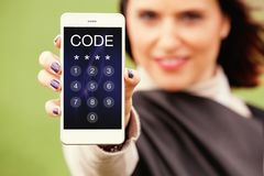 Woman showing mobile phone with passcode in the screen. Unlocking phone. Unlocking phone pass code in a mobile screen. Security and protection concept Royalty Free Stock Image
