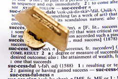 Unlocking Success. Key in lock with definition of success Royalty Free Stock Photography