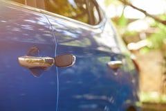 Unlocking vehicle door. Theme. Key left in car lock Royalty Free Stock Images