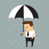 Unlucky businessman being wet from raining instead he holding um Stock Images