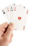 Unlucky cards. A hand holding 4 unlucky aces (poker Royalty Free Stock Photos