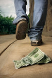 Unlucky man drops money. Photo of an unlucky man that just lost two hundred dollars Stock Photos
