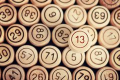Unlucky number 13 on the background of wooden barrels lotto. Clo. Se up Royalty Free Stock Images