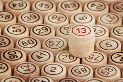 Unlucky number 13 on the background of wooden barrels lotto. Clo. Se up Royalty Free Stock Photos