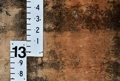 Unlucky thirteen sign. Water depth monitoring levels on wall royalty free stock photography