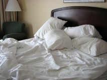 Unmade bed stock photography
