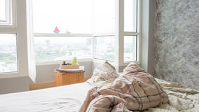 Unmade bed with crumpled bed sheet. Royalty Free Stock Images