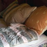 Unmade bed and crumpled linen. In a morning light, indoor closeup stock photos