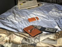 Unmade Bed And Gadgets Royalty Free Stock Image