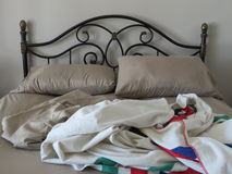 Unmade bed Stock Images