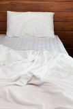 An Unmade bed and pillow Stock Photography