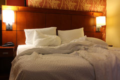 Unmade bed. Unmade ruffled white motel hotel bed Royalty Free Stock Photo