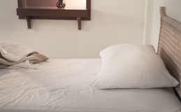 An unmade bed with white linens Royalty Free Stock Images