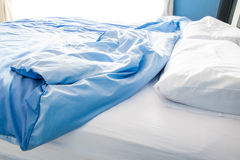 Unmade bed with white pillow. And messy Royalty Free Stock Photos