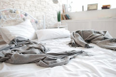 Unmade messy bed after lovers in motel Stock Image