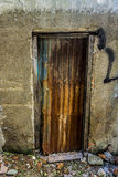 Unmanaged and rusty old vintage door made from steel photo taken in Jakarta Indonesia. Java Royalty Free Stock Image