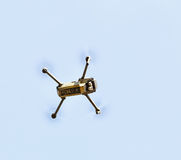 Unmanned aerial vehical with video camera hovers in the air. Thi Royalty Free Stock Photo