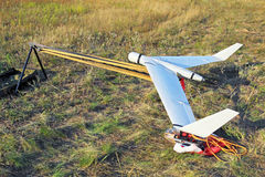 Unmanned aerial vehicle. The unmanned aerial vehicle in the field ready to start stock photography